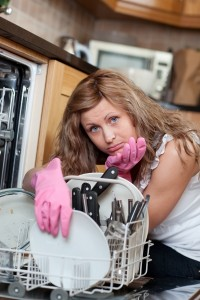 3680882-tired-cute-woman-filing-the-dishwasher